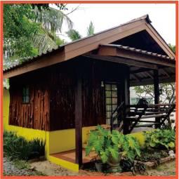 wooden bungalow in garden setting
